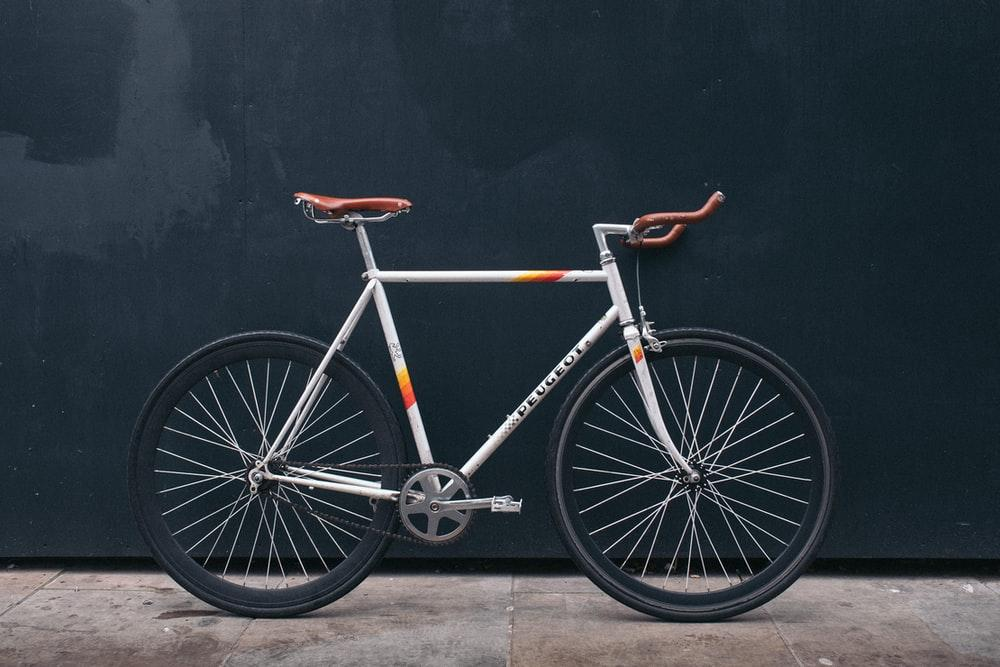 List of Top Bicycle Shops in Singapore with gray fixie bike leaning on black wall